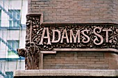Decorative street sign incorporated into building, The Rookery, Chicago, USA.
