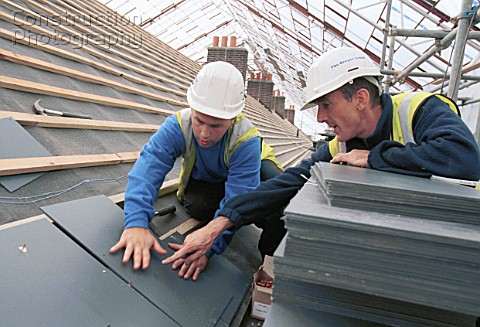 Roof SlatingYoung apprentice learning trade skills on site