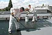 Liquid Applied Roofing. Using a roller.