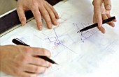 Close-up of interior designers drawing up plans