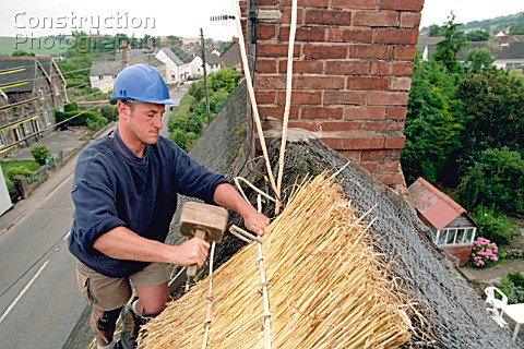 Thatching at apex of roof of Somerset cottage United Kingdom