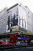 Advertisement Hoarding covering a building under refurbishment in central London.