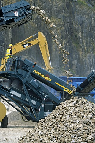 Caterpillar crawler excavator and Powerscreen Chieftain 600 aggregate screen on site