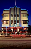 1930s Art Deco architecture, at night depicting neon lights and passing cars, Miami Beach, USA.