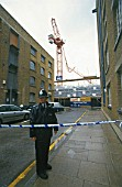 Tower Crane accident in South London. The crumpled jib hangs precariously over the building site
