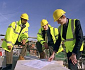 Construction managers looking at plans on housing development