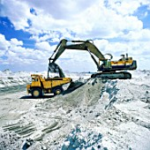Komatsu PC1000 crawler excavator and rigid dumper truck. Volcanic Ash. Philippines. Year 1998.