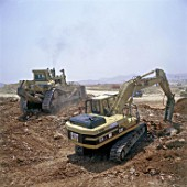 Caterpillar 325LN crawler excavator with breaker attachment, and Caterpillar D11N bulldozer.