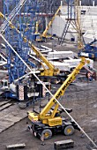Wheeled mini crane and tracked heavy duty crane. Gelsenkirchen Stadium. Germany.