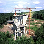 Cable suspended Arch Concreting work on motorway Bridge. Germany.