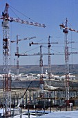 Multiple Tower Cranes for the new terminal at Madrid Airport. Spain. July 2001.
