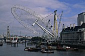 Erection of London Eye, Millennium Wheel. London, United Kingdom. Designed by David Marks and Julia Barfield.