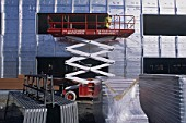 Scissor Lift for aluminium cladding work. Vodafone Offices. United Kingdom. 2002.