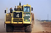AMPL Caterpillar grader. M6 toll road construction, Birmingham, United Kingdom.