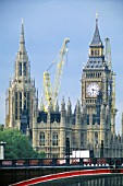 Tower crane behind Lambeth Bridge and Houses of Parliament. London. United Kingdom.