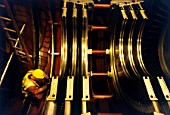 On site assembly of main gas power turbine (250MW) for new power station in Spalding, East Anglia, United Kingdom. The technician checks tolerances on the lower turbine housing blade seatings.