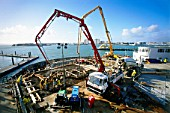 Concrete pour for foundation raft for a high rise apartment block, Spinnaker Tower in Portsmouth, UK.