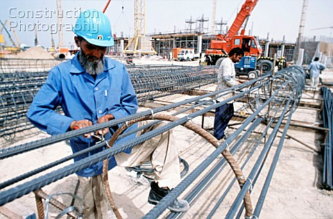Tying reinforcement for a cylindrical pile cage Dubai Mall Development UAE