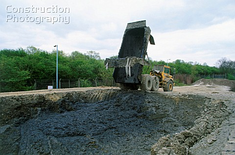 Dump trailer used to transport sludge for disposal in a lagoon