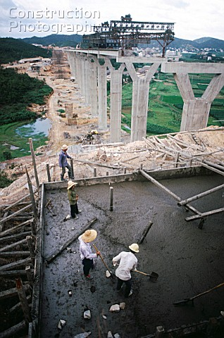 Approach viaducts being concreted for the Boca Tigris Pearl River suspension bridge in southern Chin
