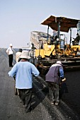 Asphalting pavers working on the top layer of the new runways at the new international Suvarnabhumi Bangkok Airport