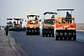 Tyred compactors used to achieve smooth finish on runway asphalt at international Suvarnabhumi Bangkok Airport, Thailand