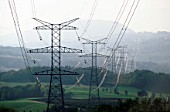 High tension power lines across the Alpine foothills near Annecy, Rhone-Alpes, France