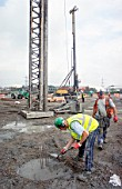Keller piling for cast in site piling on the Prologis distribution centre at Dartford -the piles are finished with an inverted cone top that limits punching shear on the later cast slab, Dartford distribution centre - piling