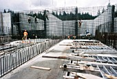 Fixing formwork for water tank walls at the new Vancouver water treatment plant in Canada - workers are mainly Quebecois filling in because of severe labour shortages in Western Canada