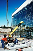 Italian Carrera white marble panels lifted for roofing by the glass facade, Oslo Opera, Norway