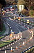 Coned off lanes for the tunnelling works on the Devils punchbowl Hindhead on the A3 road to Portsmouth, Hampshire, UK