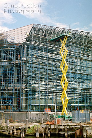 Large size scissor lift used for access on the new convention centre building under construction in