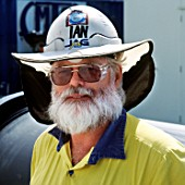 Sun protection helment on a worker on a water project just outside Brisbane in Queensland Australia.  The helmets are now virtually standard wear as are long sleeves and long trousers.