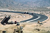Rolling the asphalt for a section of the Medina-Jedda motorway in the mountains near Medina in Saudi Arabia
