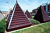 Pyramid shapes for ventilation vents on the central grass courtyard between apartments in Old Portsmouth, Hampshire, UK