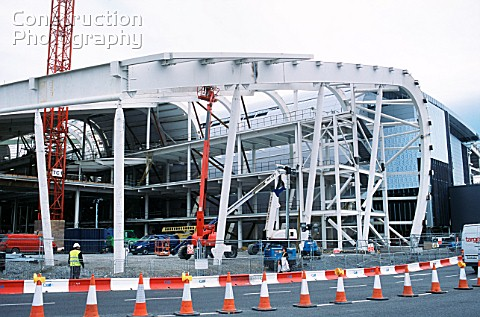 Curved steel frame is worked on from a platform for the new Dublin airport terminal