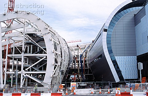 Curved steel frame is worked on from a variety of platformsw for the new Dublin airport terminal
