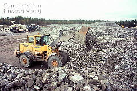Crushed rock is loaded at a recycling yard on the Bothnia railway in Sweden where blasted rock from