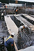 Fixing formwork for concreting Calgary Wastwater treatment plant Alberta, Canada