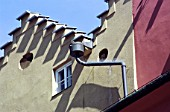 Special bucket collector for snow on guttering on traditional buildings in Innsbruck, Austria