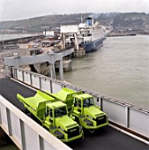 Terex 2366 articulated dumper trucks being unloaded from ferry.