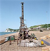 Drilling on a beach.