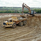 Caterpillar D400D articulated dumper truck and Komatsu crawler excavator.