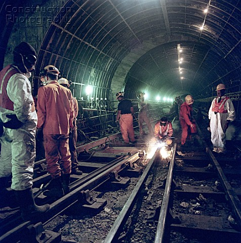 Cutting third rail to length during refurbishment of Angel Underground station London United Kingdom