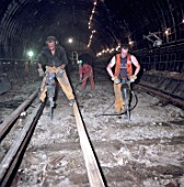Excavating track bed during refurbishment of Angel Underground station. London, United Kingdom.