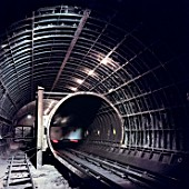London Underground train in tunnel during refurbishment of Angel Underground station. London, United Kingdom.