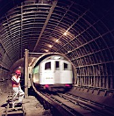 London Underground train entering tunnel during refurbishment of Angel Underground station. London, United Kingdom.