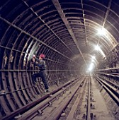 Inspecting segmental tunnel lining during refurbishment of Angel Underground station. London, United Kingdom.