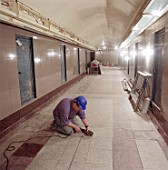 Flooring works in passenger tunnel during refurbishment of Angel Underground station. London, United Kingdom.