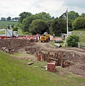 Creating a culvert for stream diversion. A4251 Hemel Hempstead to Berkhamsted road refurbishment scheme, Hertfordshire, United Kingdom.